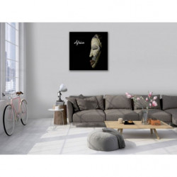 African mask on black background