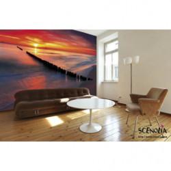 Póster panorámico de una puesta de sol en un mar turquesa