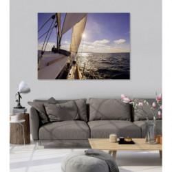 Tableau voilier en mer avec coucher de soleil