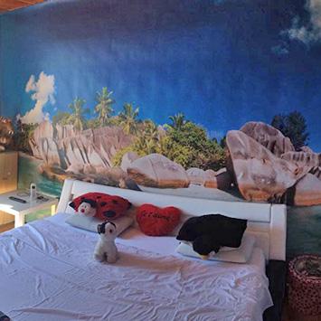 Papier peint sugar island tete de lit chez Jenny